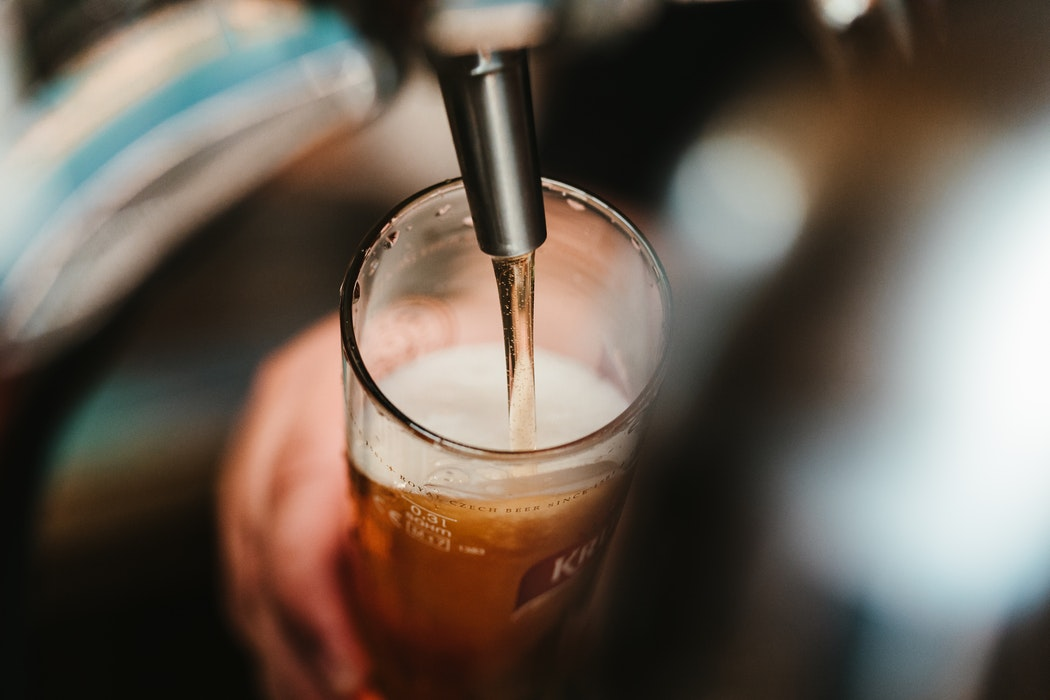Beer being poured from a tap.